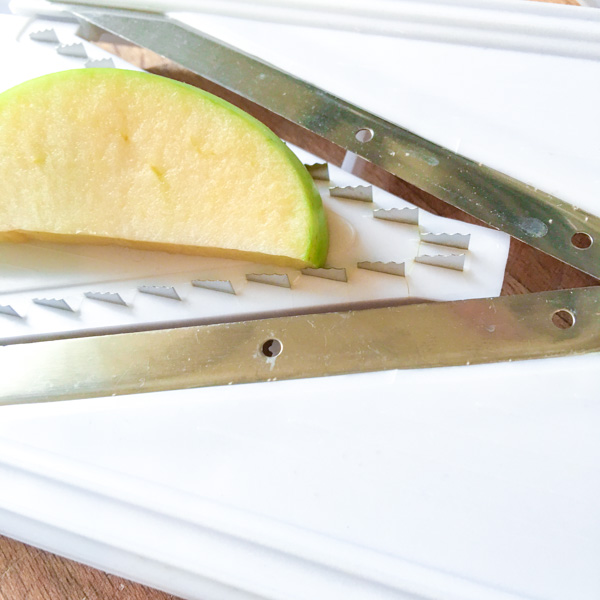 cutting aapples for a contemporary Waldorf Salad